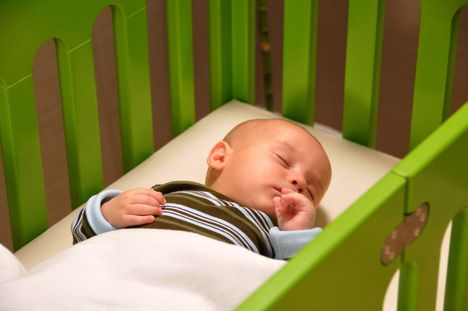 how old should a baby be to sleep in bed with parents 2