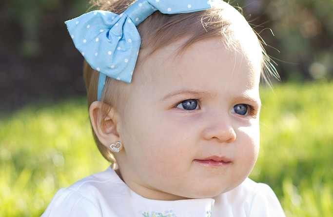 People S Opinions On The Newest Hot Topic Baby Ear Piercing Are Divided Some Pas Claim That Babies With Pierced Ears Look Adorable While Others Think