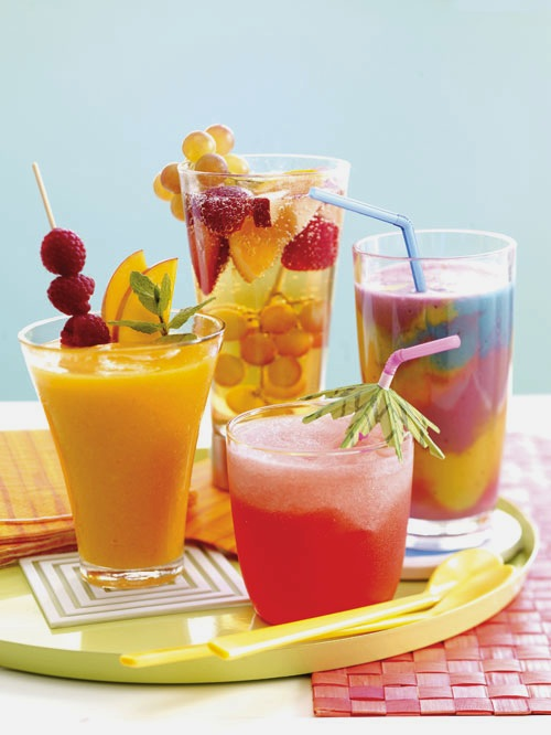 Icy Tropical DrinksAdd The Fruits Like Pineapples Kiwis Bananas And Citrus In A Table Presentable Hued Bowl Full With Drinks